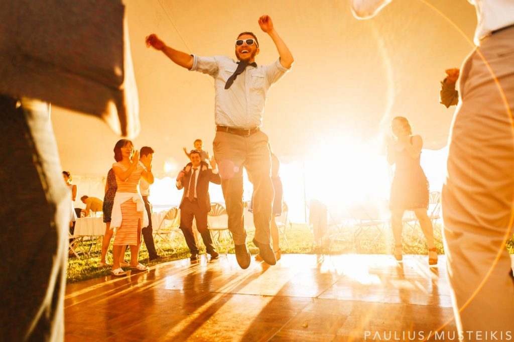 James Madison Park wedding guests dancing backlit by bright afternoon sun