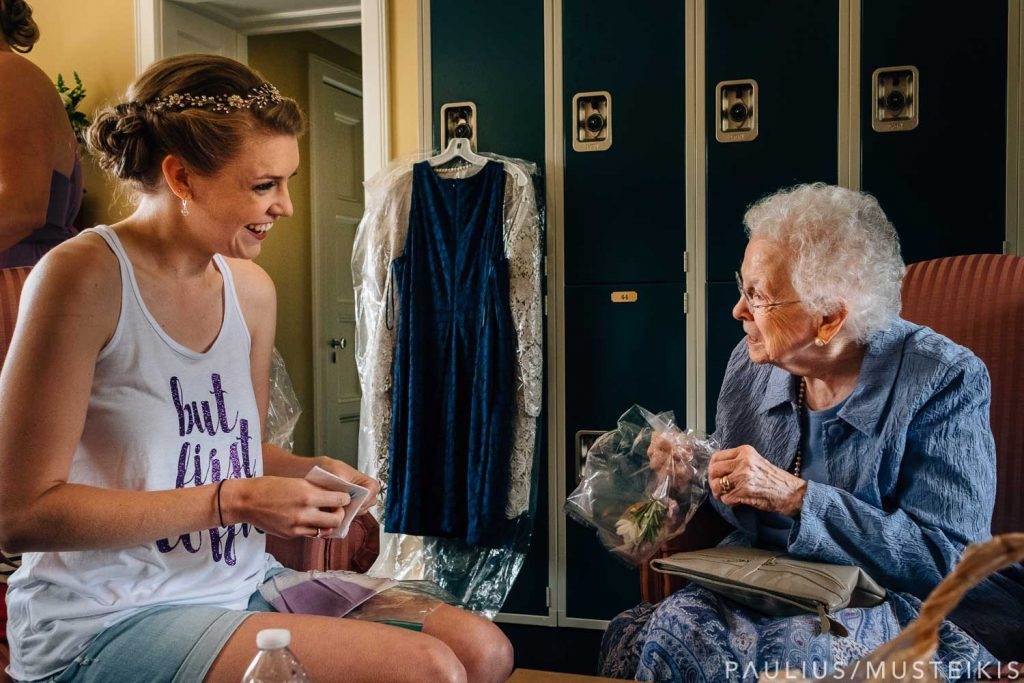 bride helping her grandmother with jewelry before Bishops Bay wedding ceremony in Middleton, Wisconsin
