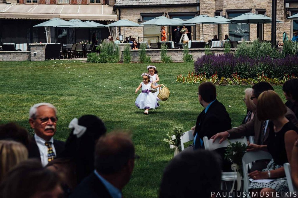 flower girls dropping flower petals during wedding ceremony at Bishops Bay country club