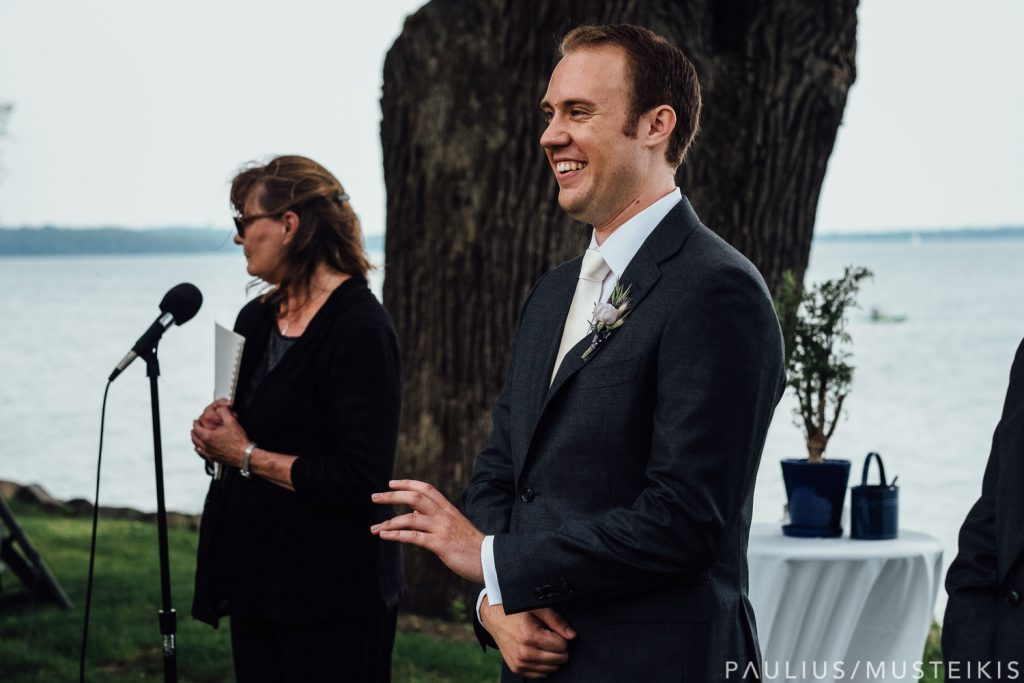 groom smile after seeing bride for the first time before the wedding ceremony in Middleton, Wisconsin