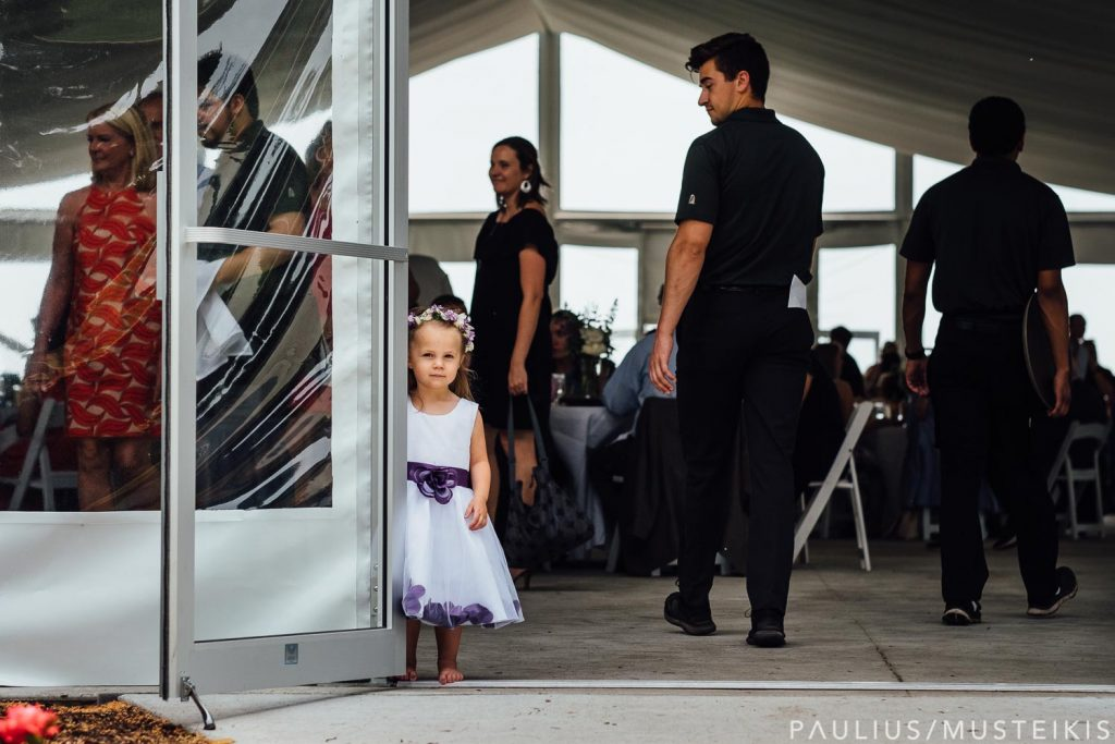 little girl in the doorway during Bishop's Bay Sunday brunch wedding reception in the tent