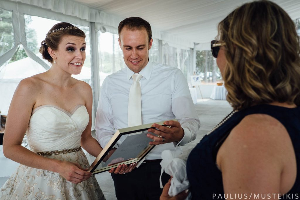 bride and groom receive framed wedding greeting signed by two United States senators