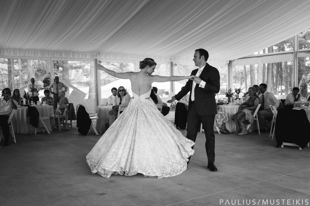 bride and groom dancing at their Bishops bay outdoor tent wedding reception in Middleton, Wisconsin