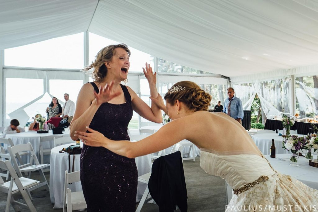 bride and her mother dancing at the Bishops bay outdoor tent in Middleton, Wisconsin