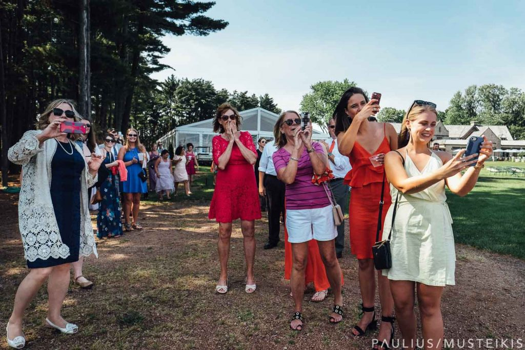 wedding guests watching departure of the newlyweds at the Bishop's bay country club