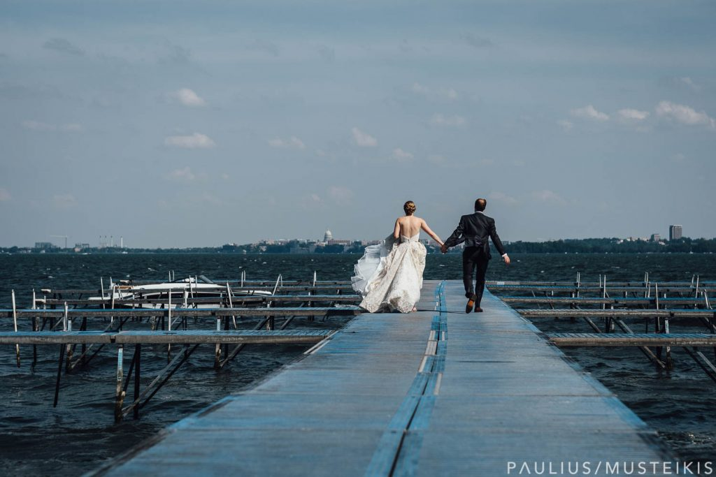 bride and groom walking down the dock for a boat departure at Bishop's Bay wedding