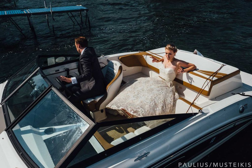 bride and groom preparing for grand departure on the speed boat