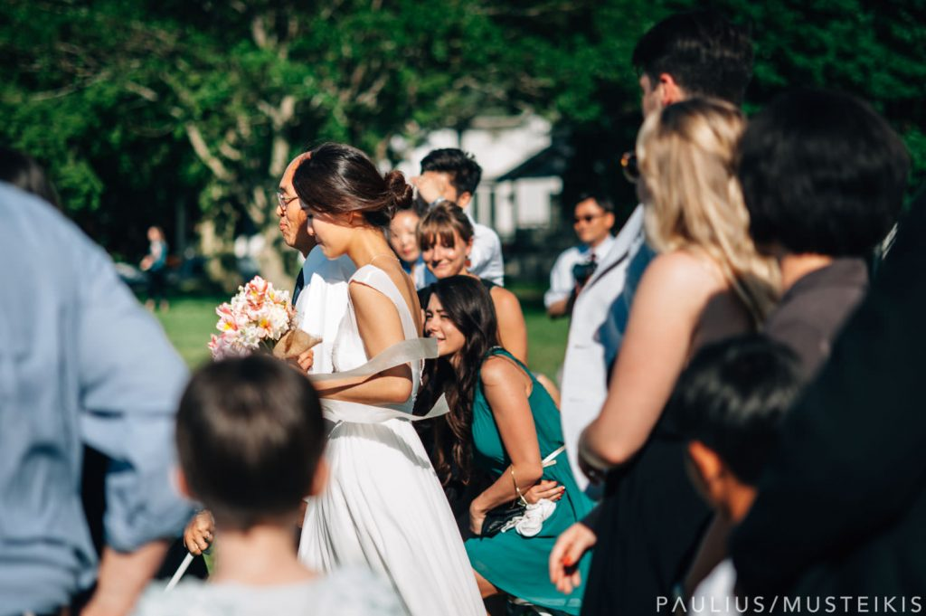 bride walks by wedding guests before James Madison park wedding ceremony