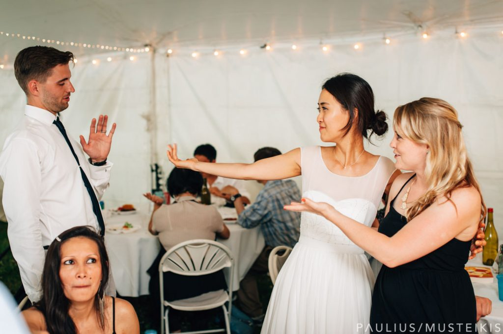 bride is hugging guests in James Madison park outdoor wedding