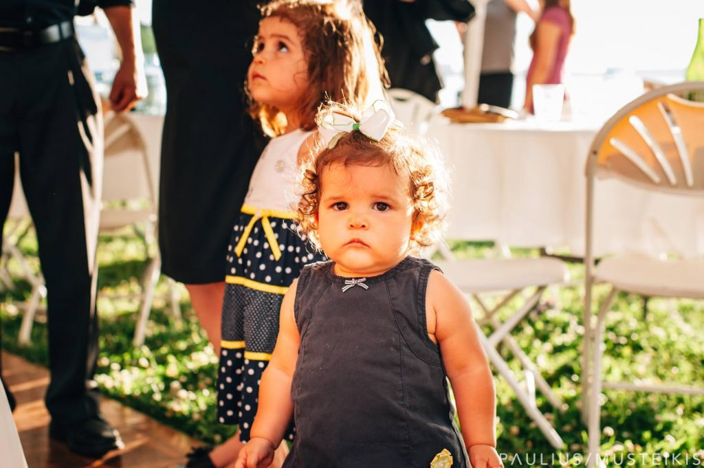 little girl on a dancefloor during wedding reception in James Madison park