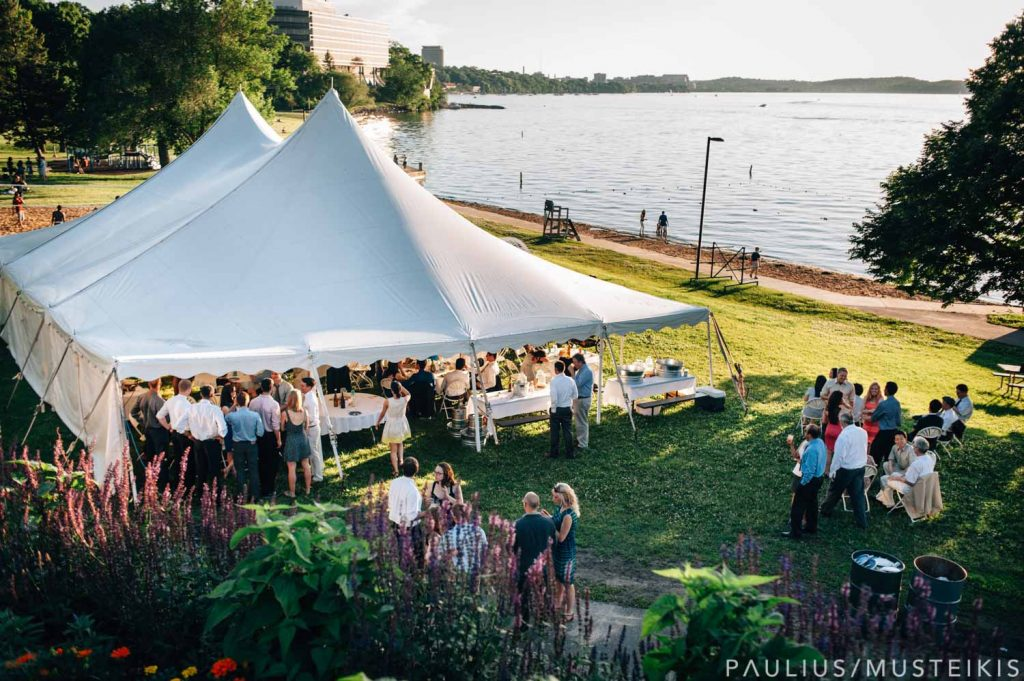 wide angle view of James Madison park with a wedding tent and lake Mendota in the background