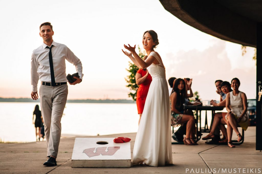 bride and groom playing bean bag toss at their James Madison park wedding reception