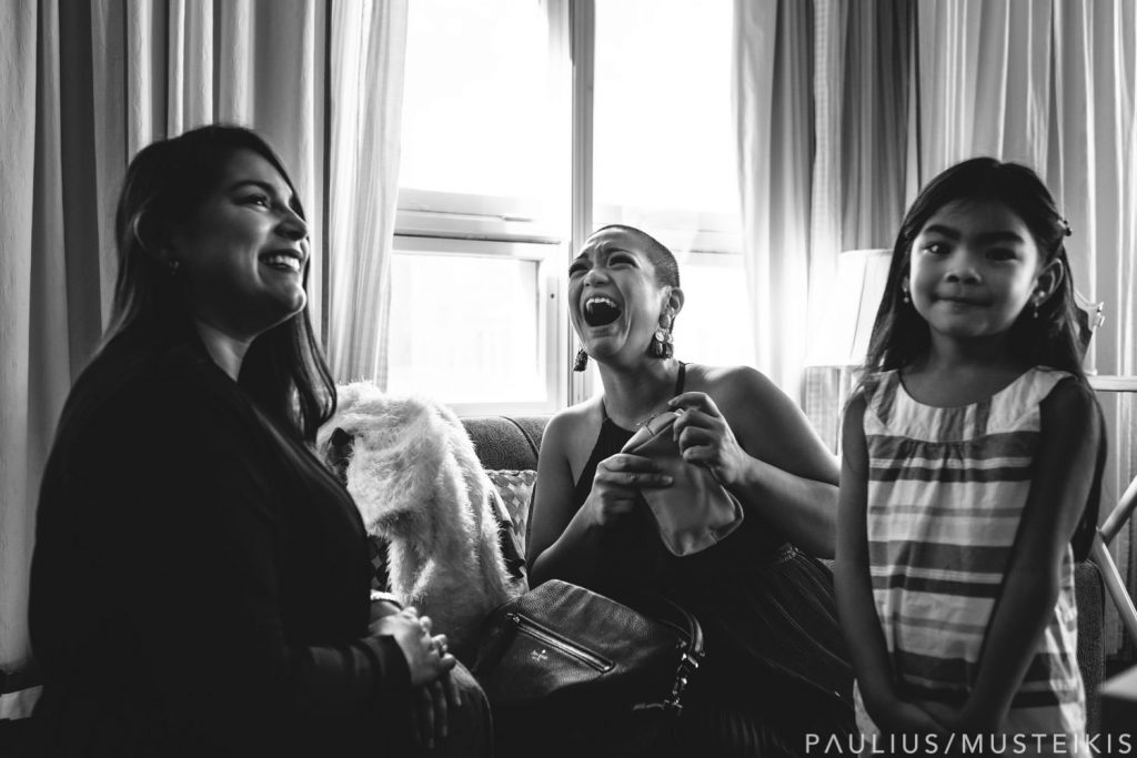 bridesmaids are laughing during getting ready in hotel Metro, Milwaukee