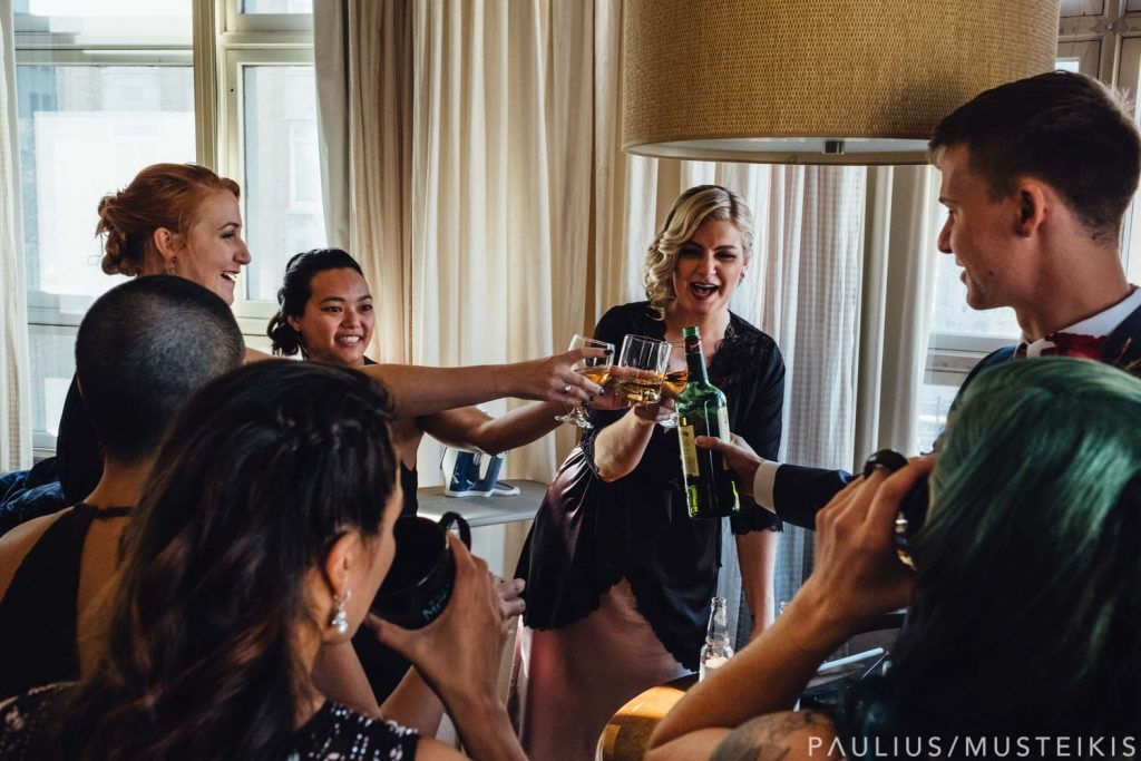 bridal party is making a toast and drinking in hotel Metro