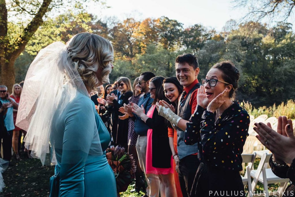 wedding guests clapping and laughing after Hubbard Park wedding ceremony