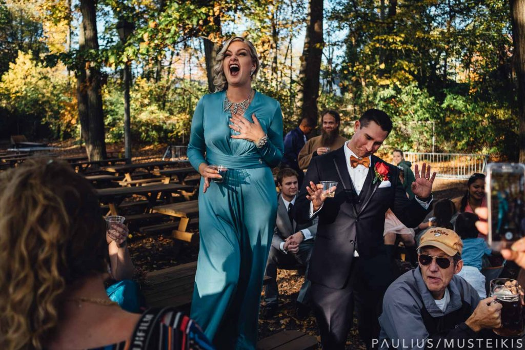 bride, groom and bridal party raising a toast in Hubbard park beer garden