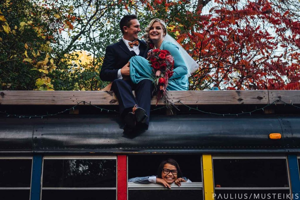 bride and groom kissing on the Partridge Family Party Bus