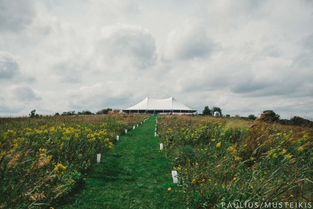Wedding reception tent in prairie Blue Mounds, Wisconsin
