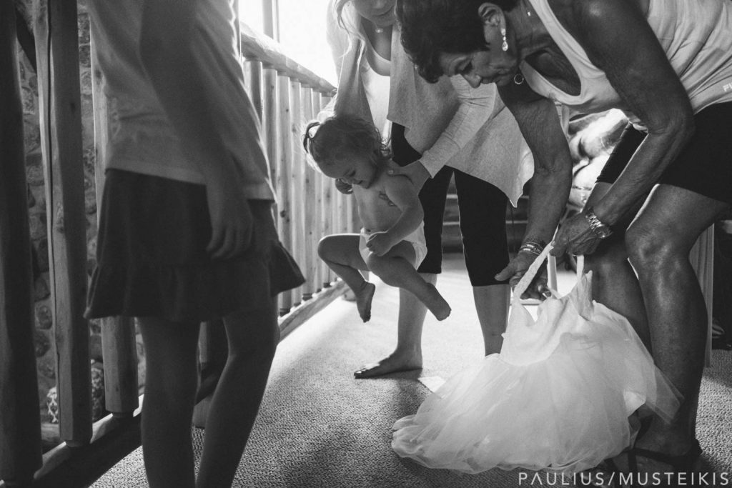flower girl being dressed