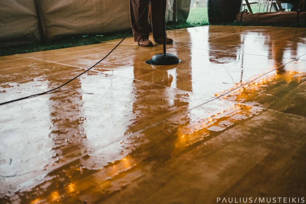 wet floor in wedding tent in Prevailing Winds lodge