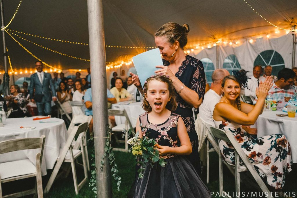 flower girl during Prevailing Winds lodge wedding ceremony