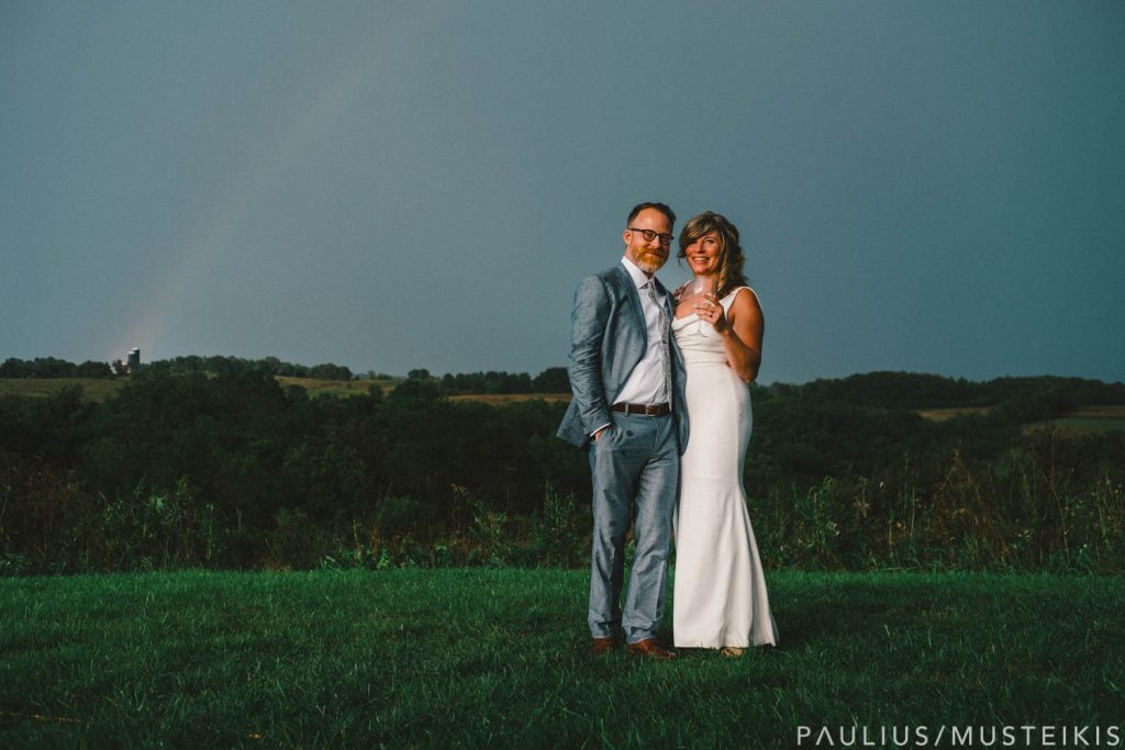 bride and groom wedding portrait in prairie near Prevailing Winds lodge