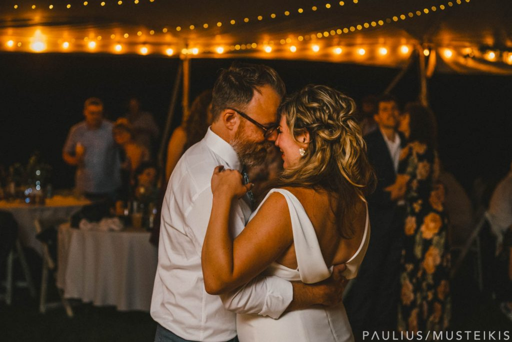 bride's and grooms first dance in Prevailing Winds lodge wedding