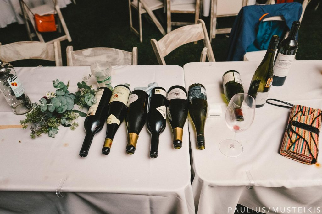 wine bottles left on table at the wedding reception