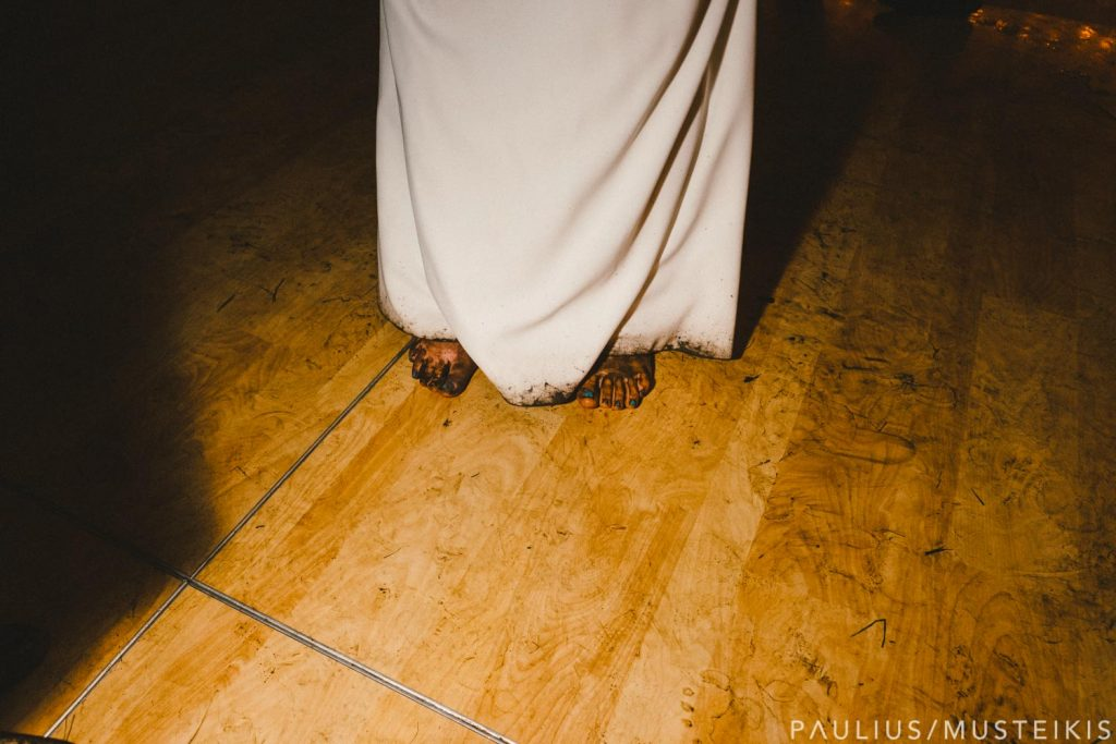 bride's dirty feet and dress covered in dirt