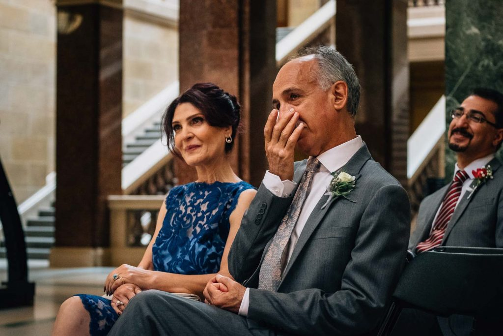 mother and father of the Persian bride tearing up during wedding ceremony