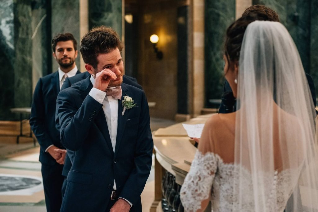 groom tearing up during wedding ceremony in Wisconsin State Capitol