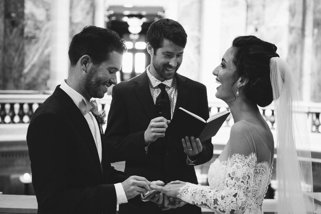 Persian-American bride laughing during wedding ceremony in Wisconsin State Capitol