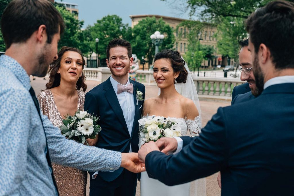 bridal party laughing outside of Wisconsin State Capitol