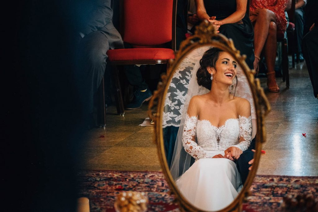 bride's reflection in mirror during Persian wedding ceremony in The University Club