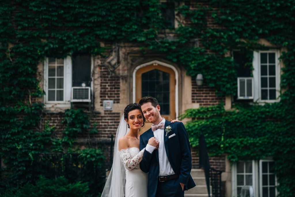 wedding portrait of bride and groom in front of the University Club in Madison, Wisconsin