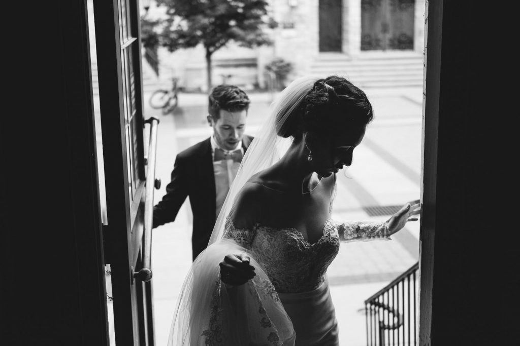 candid picture of the bride and groom walking after their University Club wedding ceremony