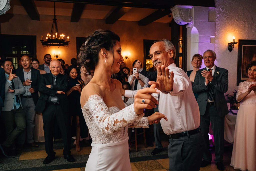 Persian bride dancing with her dad at University Club wedding reception