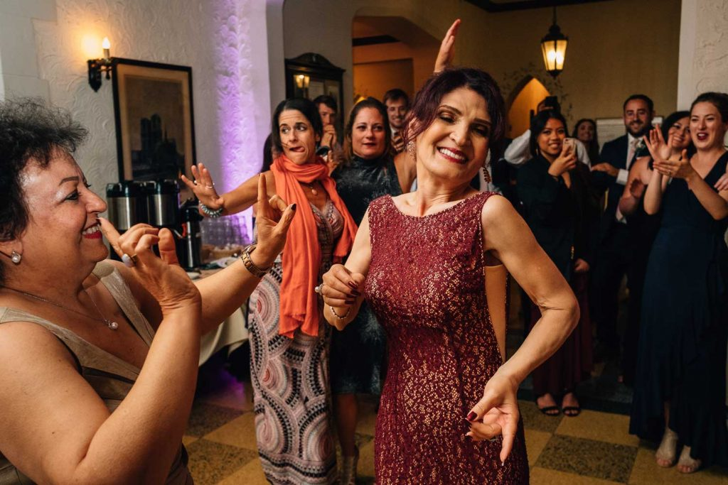 Persian-American mother of the bride dancing at the University Club wedding reception