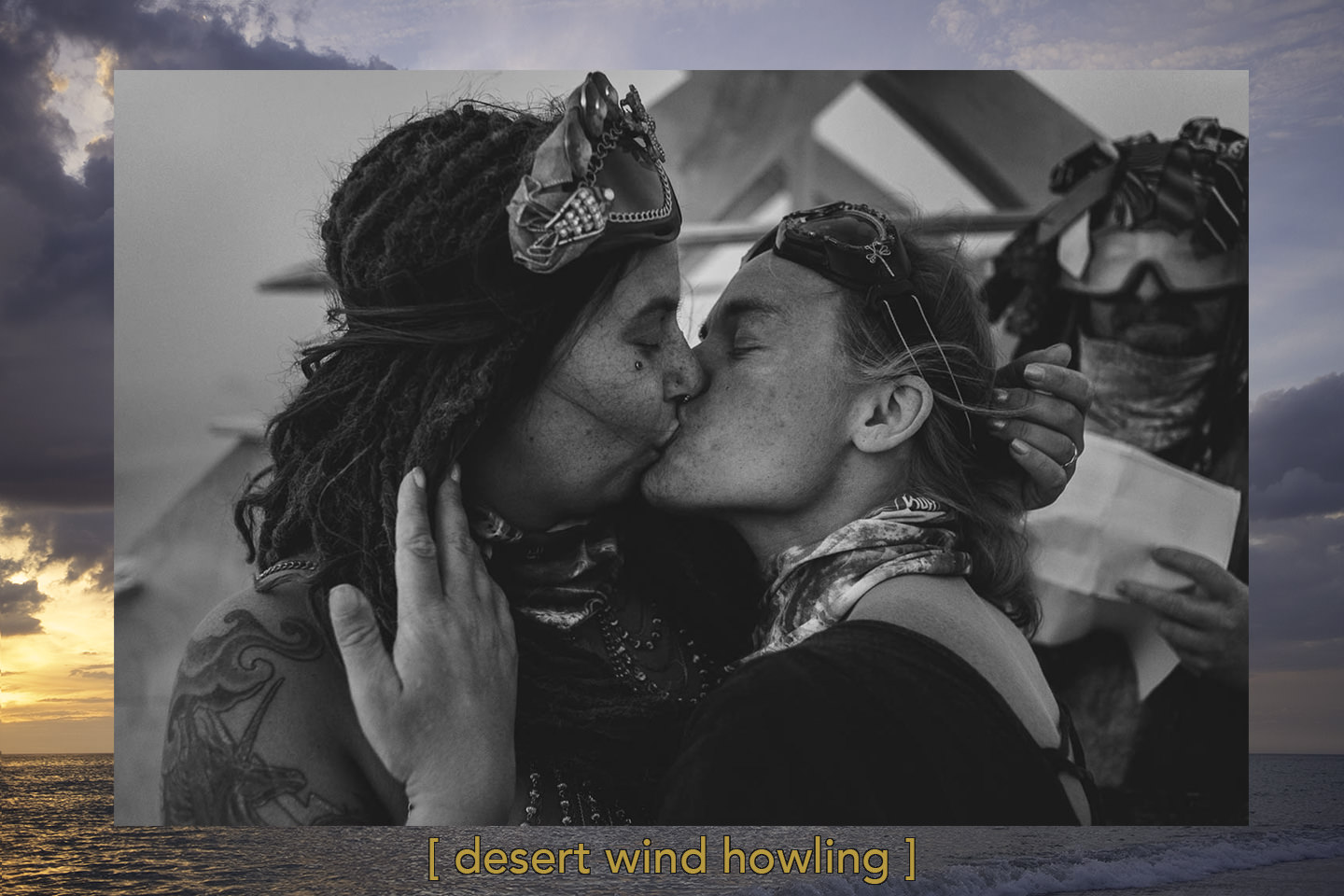 two brides are exchanging first kiss after the Burning Man wedding ceremony in Black Rock desert, Nevada